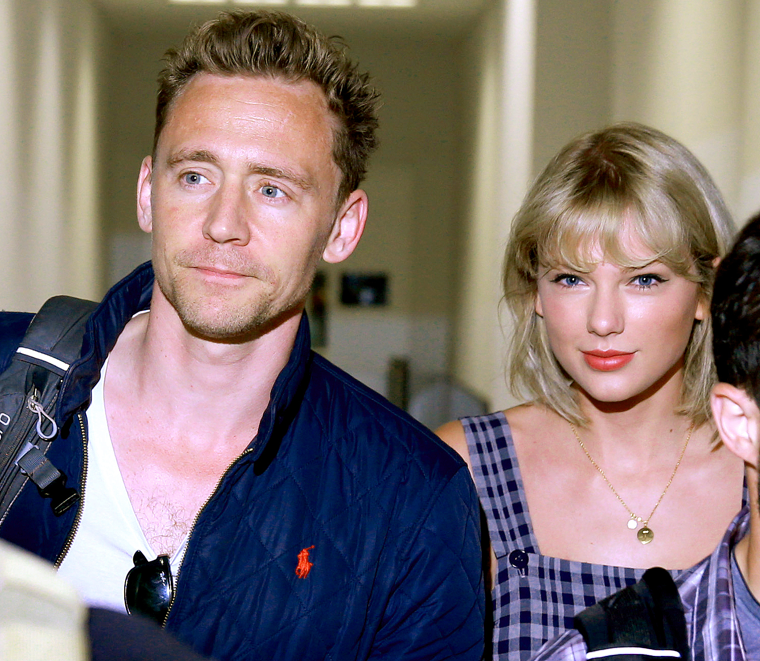 Tom Hiddleston and Taylor Swift arrive at Sydney International Airport in Sydney, New South Wales.