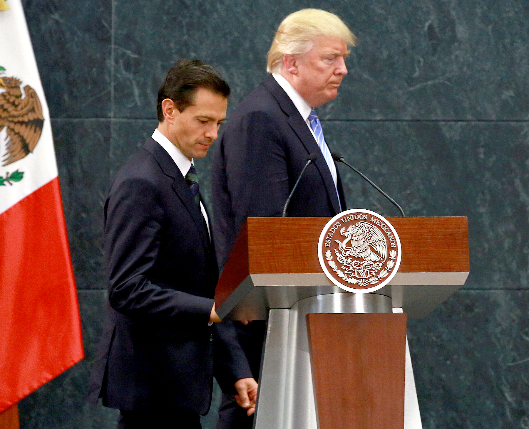 Donald Trump and Enrique Pena Nieto walk on stage for a joint conference in Mexico City, Mexico, on Wednesday, Aug. 31, 2016.
