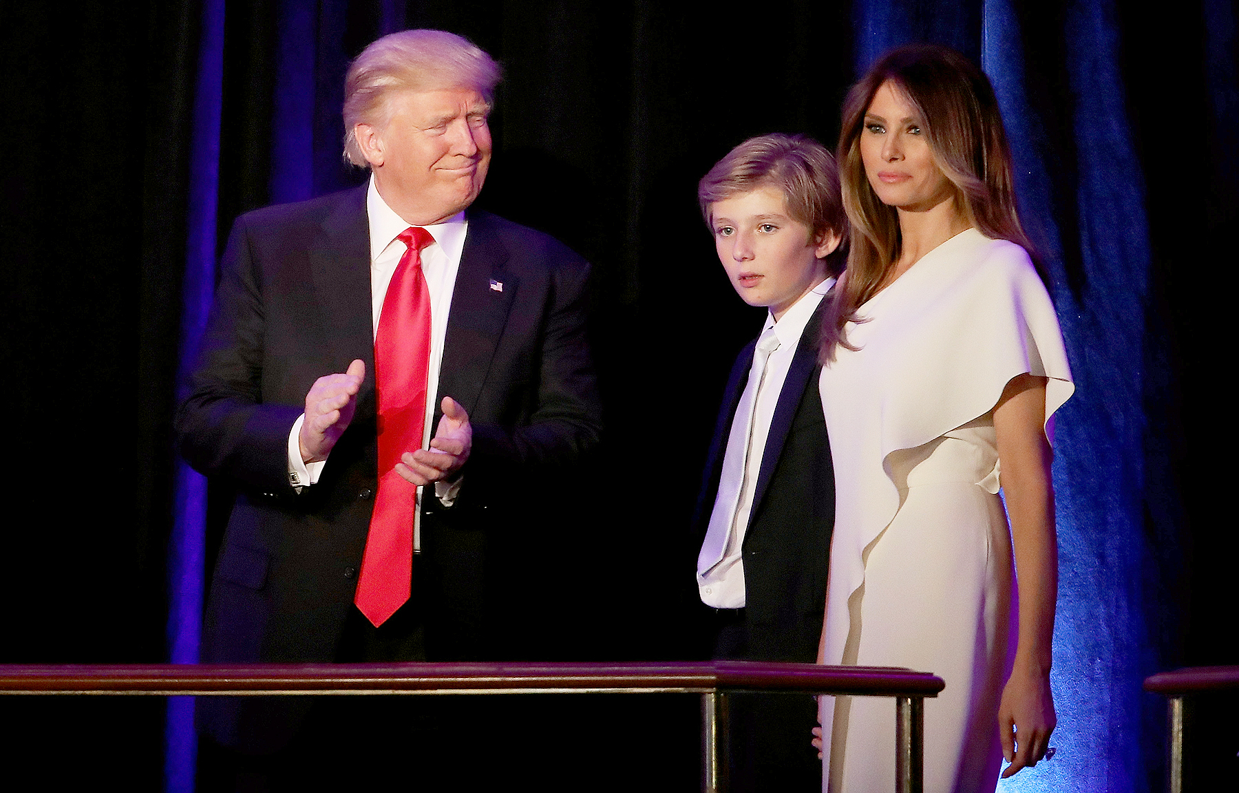 Republican president-elect Donald Trump walks on stage with his son Barron Trump and wife Melania Trump during his election night event at the New York Hilton Midtown in the early morning hours of Nov. 9, 2016, in New York City.