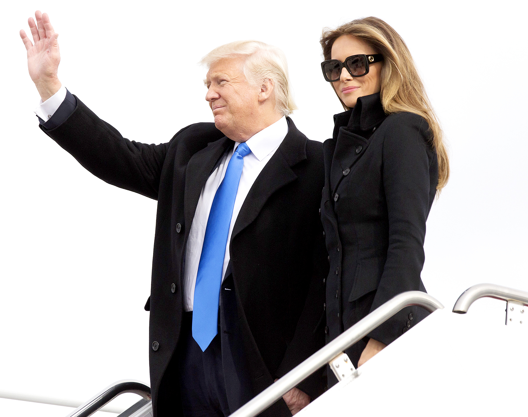 U.S. President-elect Donald Trump and his wife Melania arrive at Joint Base Andrews outside Washington, D.C., U.S., on Thursday, Jan. 19, 2017.