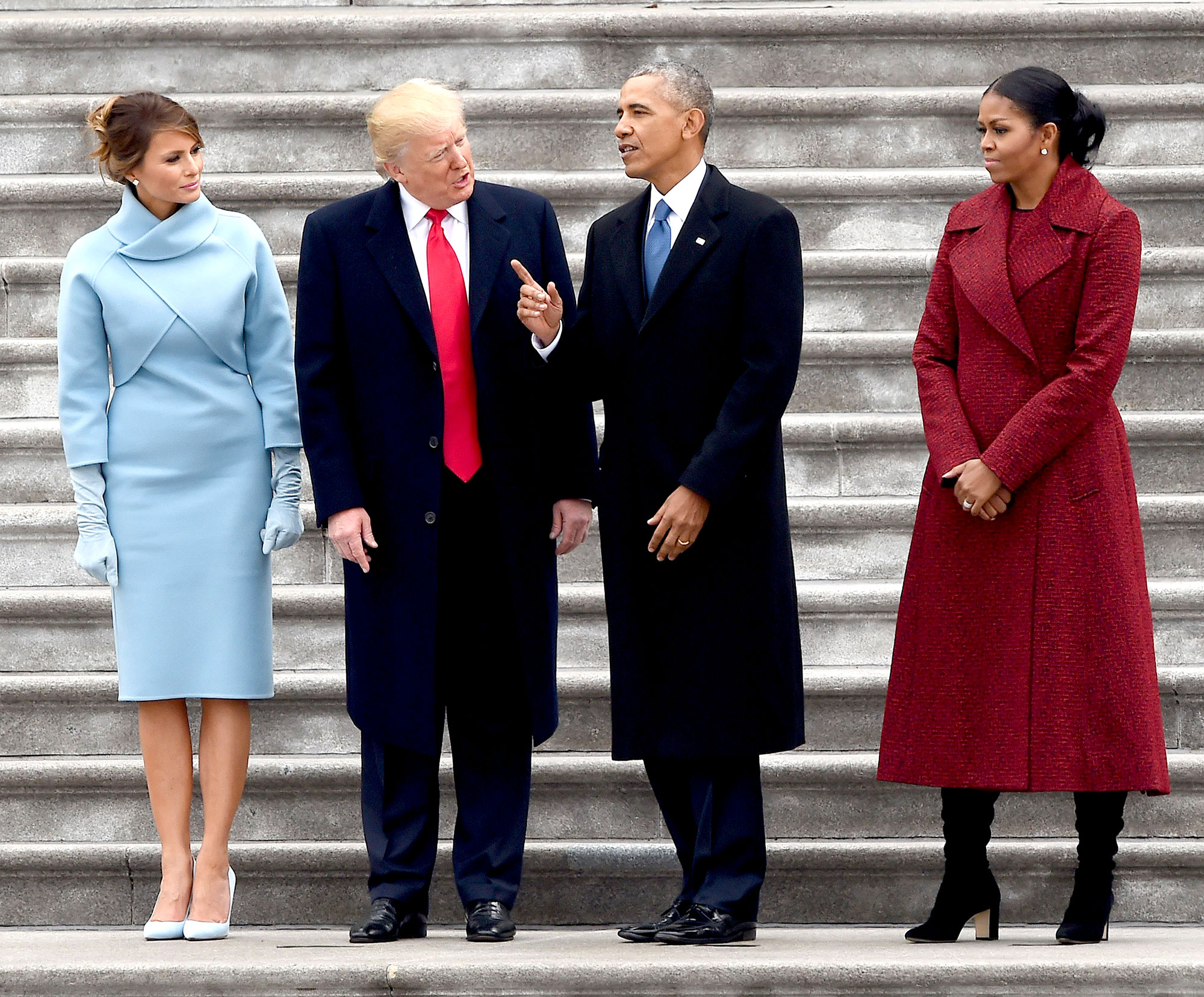 First Lady Melania Trump, President Donald Trump, former president Barack Obama and Michelle Obama stand on the steps on the east side of the United States Capitol after the inauguration ceremony on January 20, 2017, in Washington, DC.