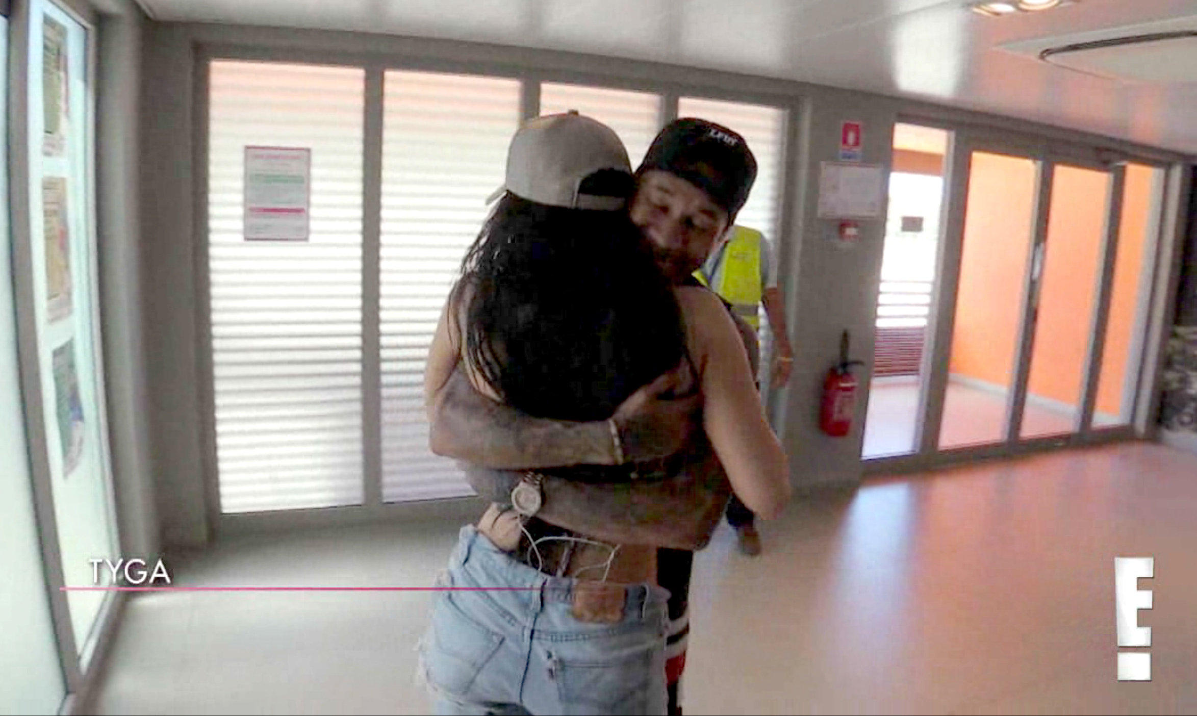 Kylie embraces Tyga.