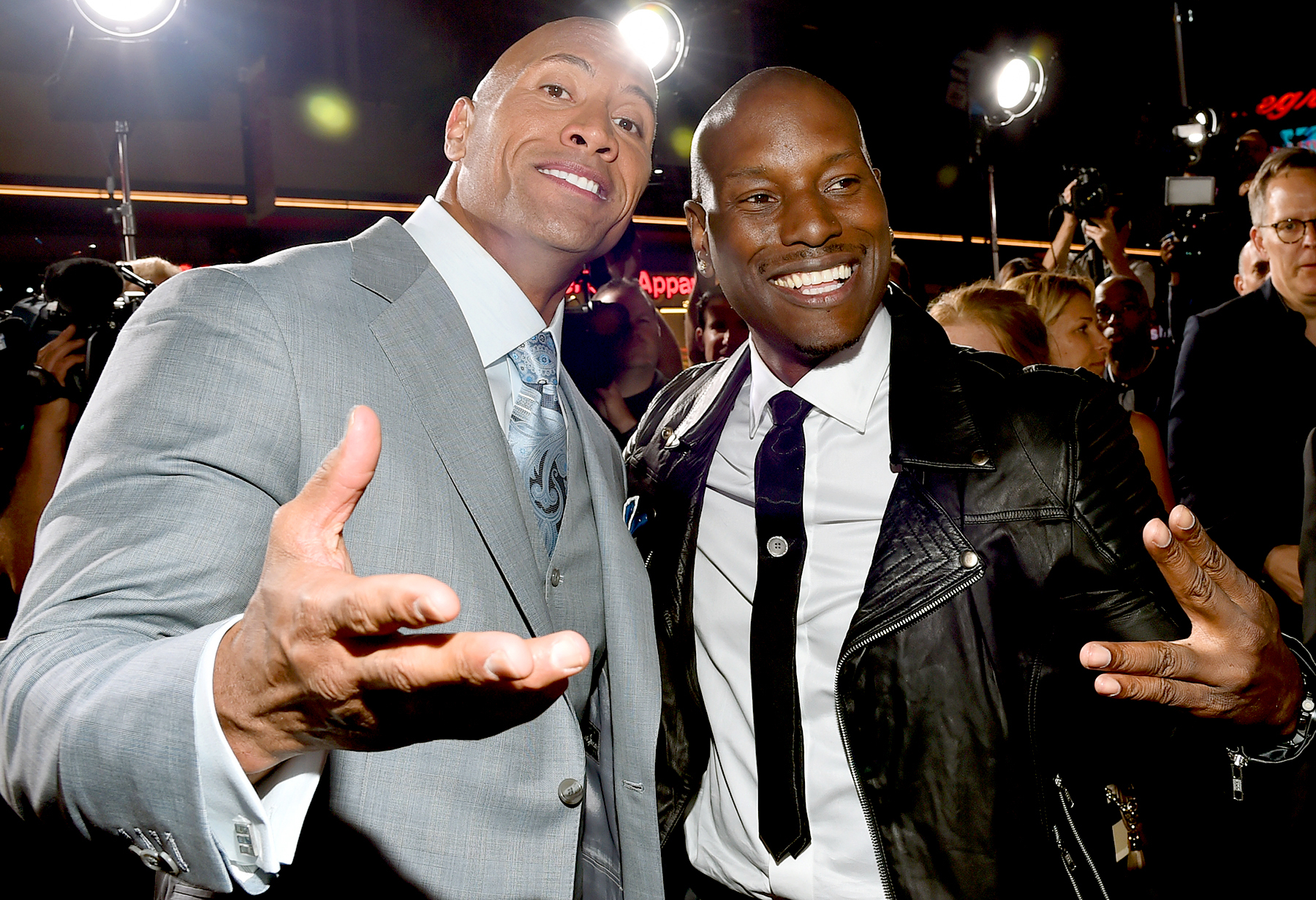 "Dwayne 'The Rock' Johnson and Tyrese Gibson attend Universal Pictures' ""Furious 7"" premiere at TCL Chinese Theatre on April 1, 2015 in Hollywood, California."