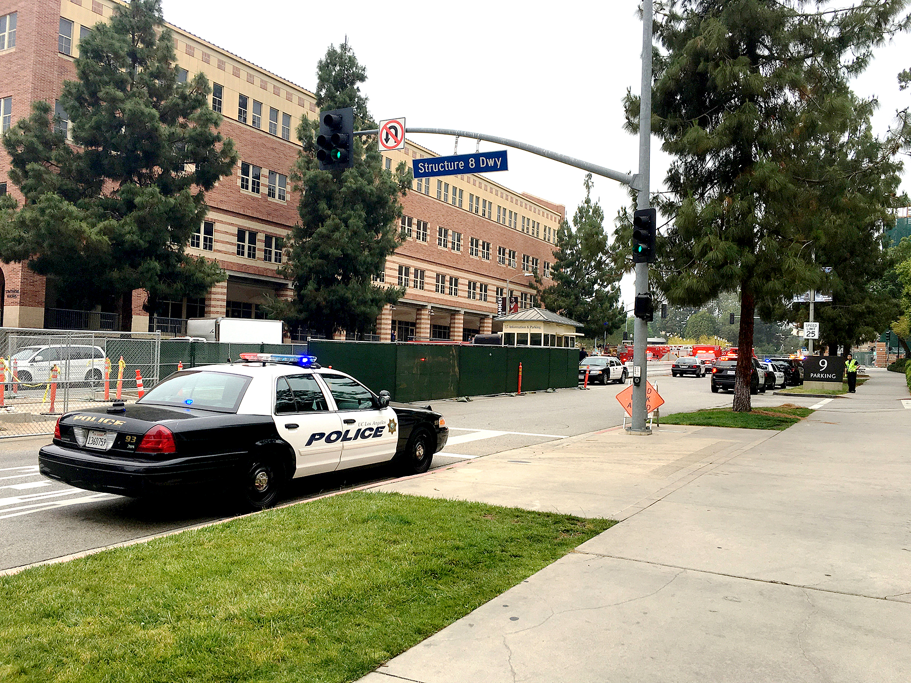 Police gather to begin search buildings on the UCLA campus as two people were killed in a shooting at UCLA on Wednesday morning, on June 1, 2016 in Los Angeles, California.