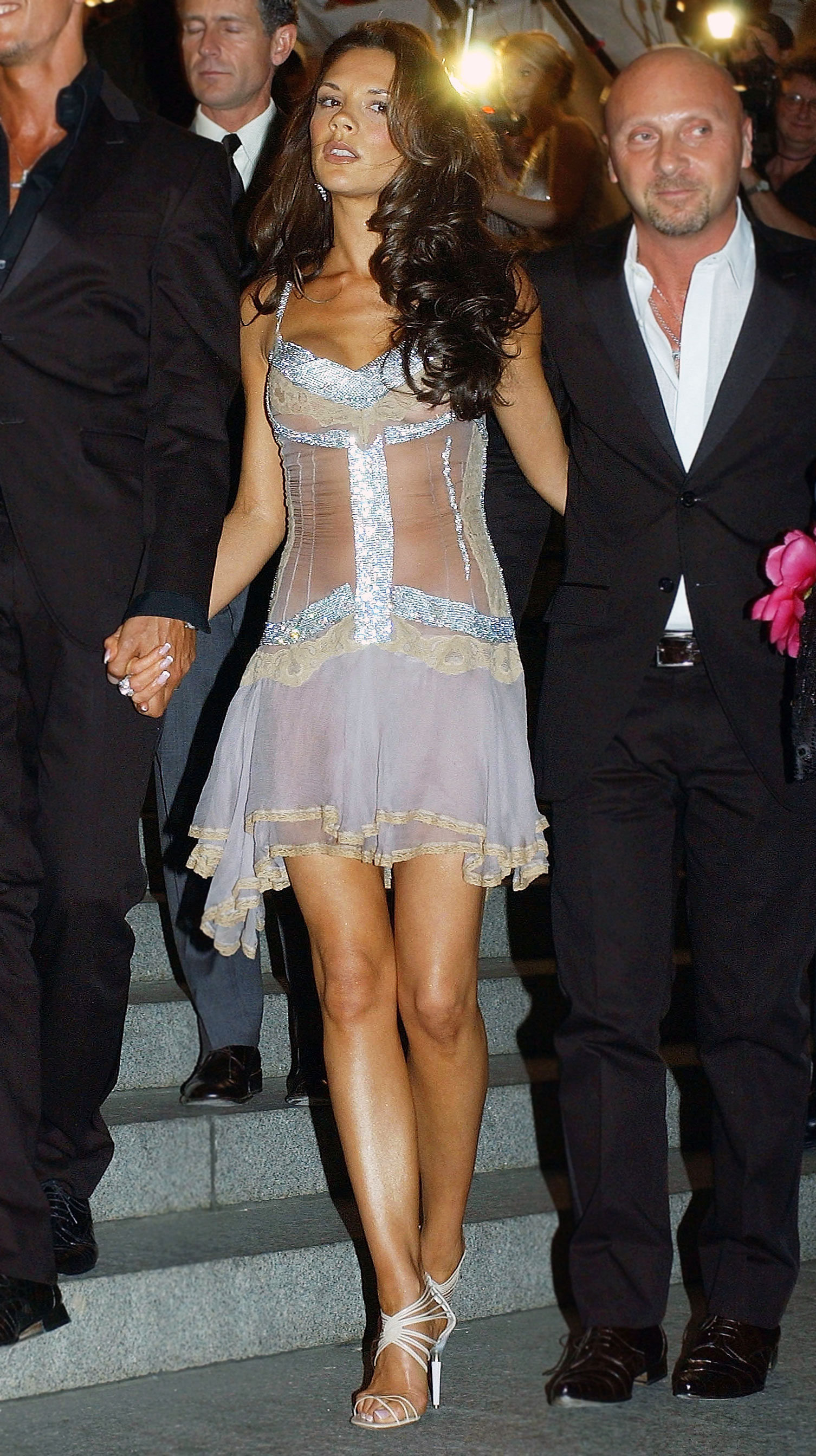 Victoria Beckham - In a lingerie-inspired frock.
