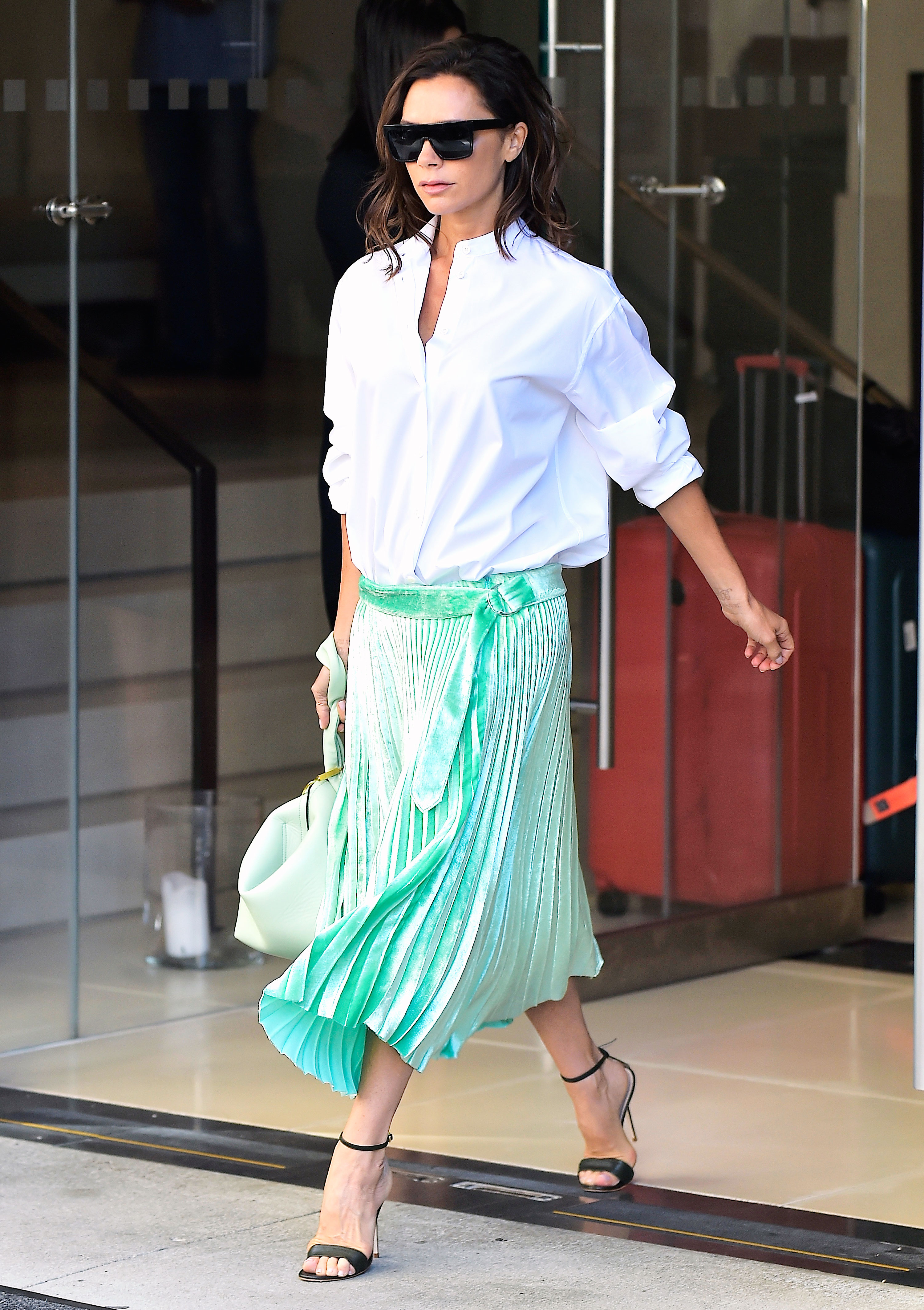 81bdf667a What to Pair With Pleated Skirts: Celeb Street-Style Photos