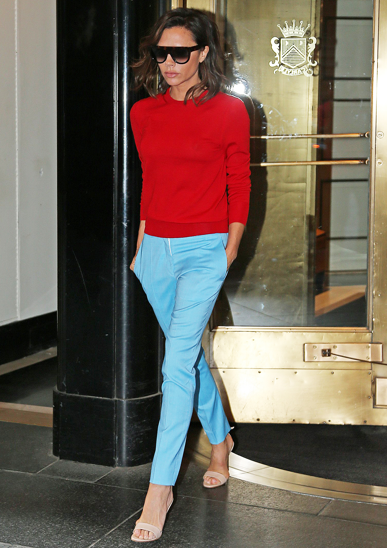 Victoria Beckham red sweater blue pants