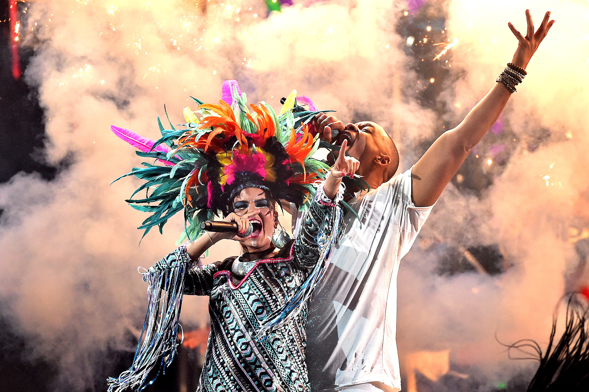 Liliana Saumet of Bomba Estereo and Will Smith perform onstage during the 16th Latin GRAMMY Awards at the MGM Grand Garden Arena on November 19, 2015 in Las Vegas, Nevada.