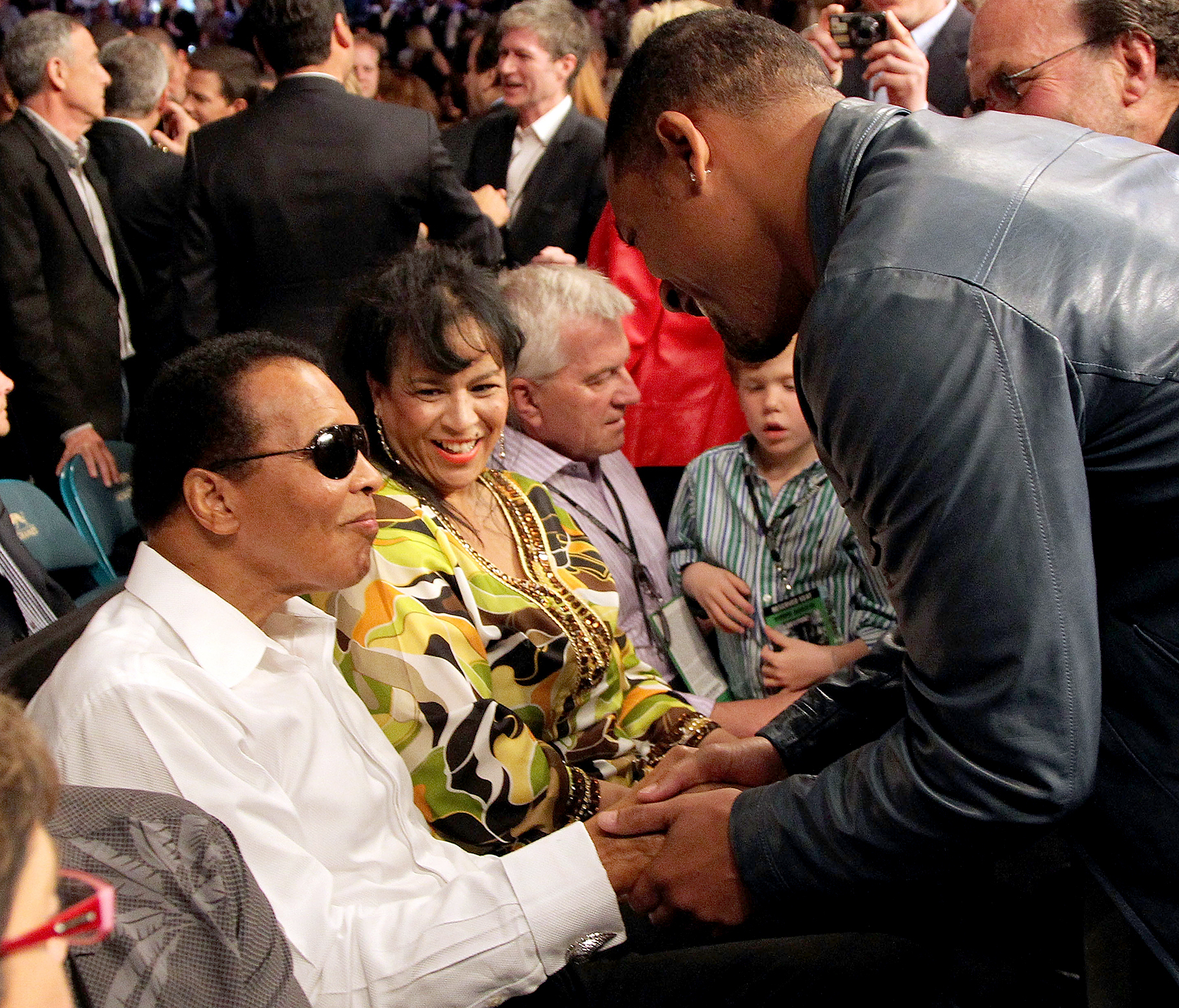 Muhammad Ali talks with actor Will Smith before the start of the Floyd Mayweather Jr. and Shane Mosley welterweight fight at the MGM Grand Garden Arena on May 1, 2010 in Las Vegas, Nevada.