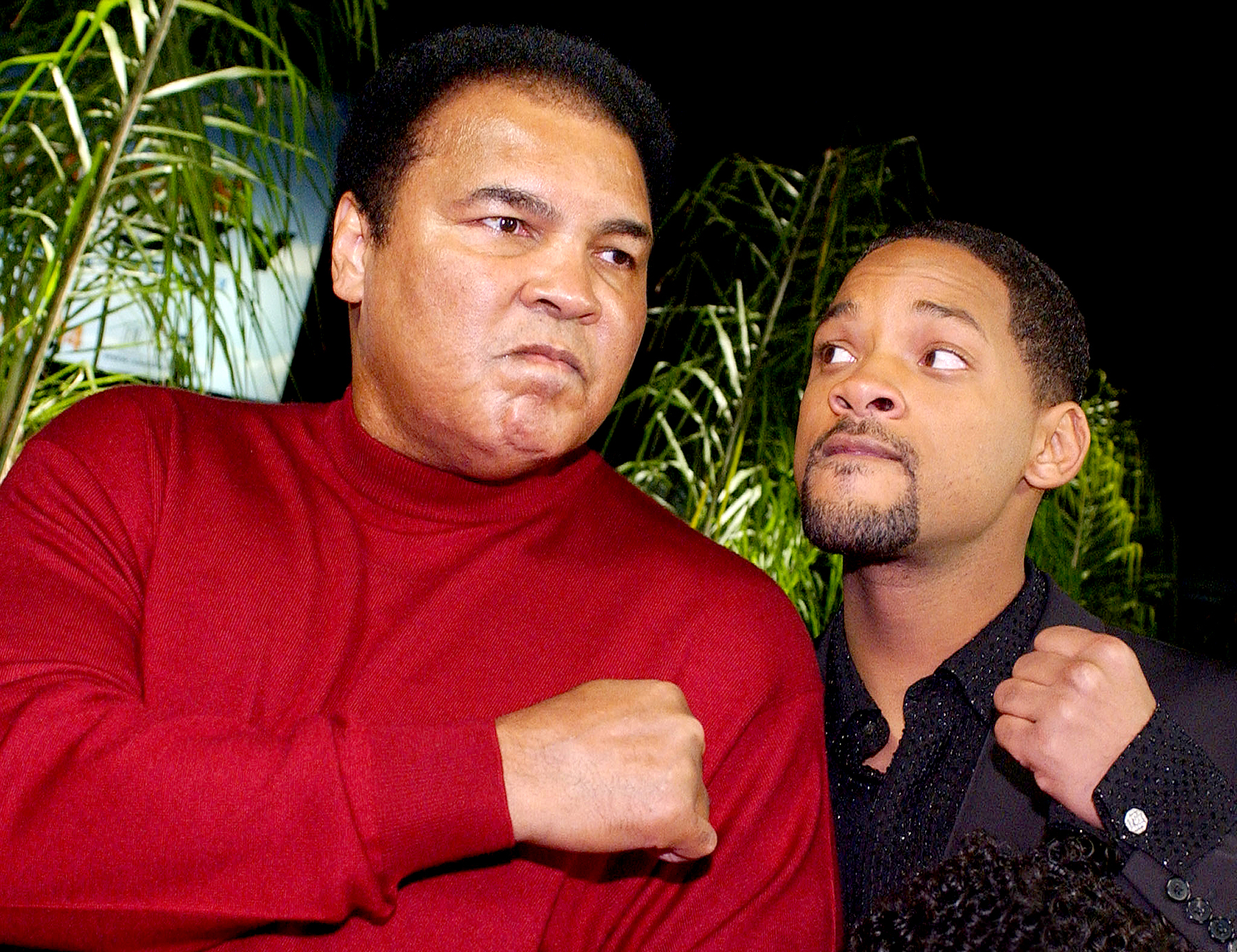 Muhammad Ali jokes with Will Smith who portrays him in film