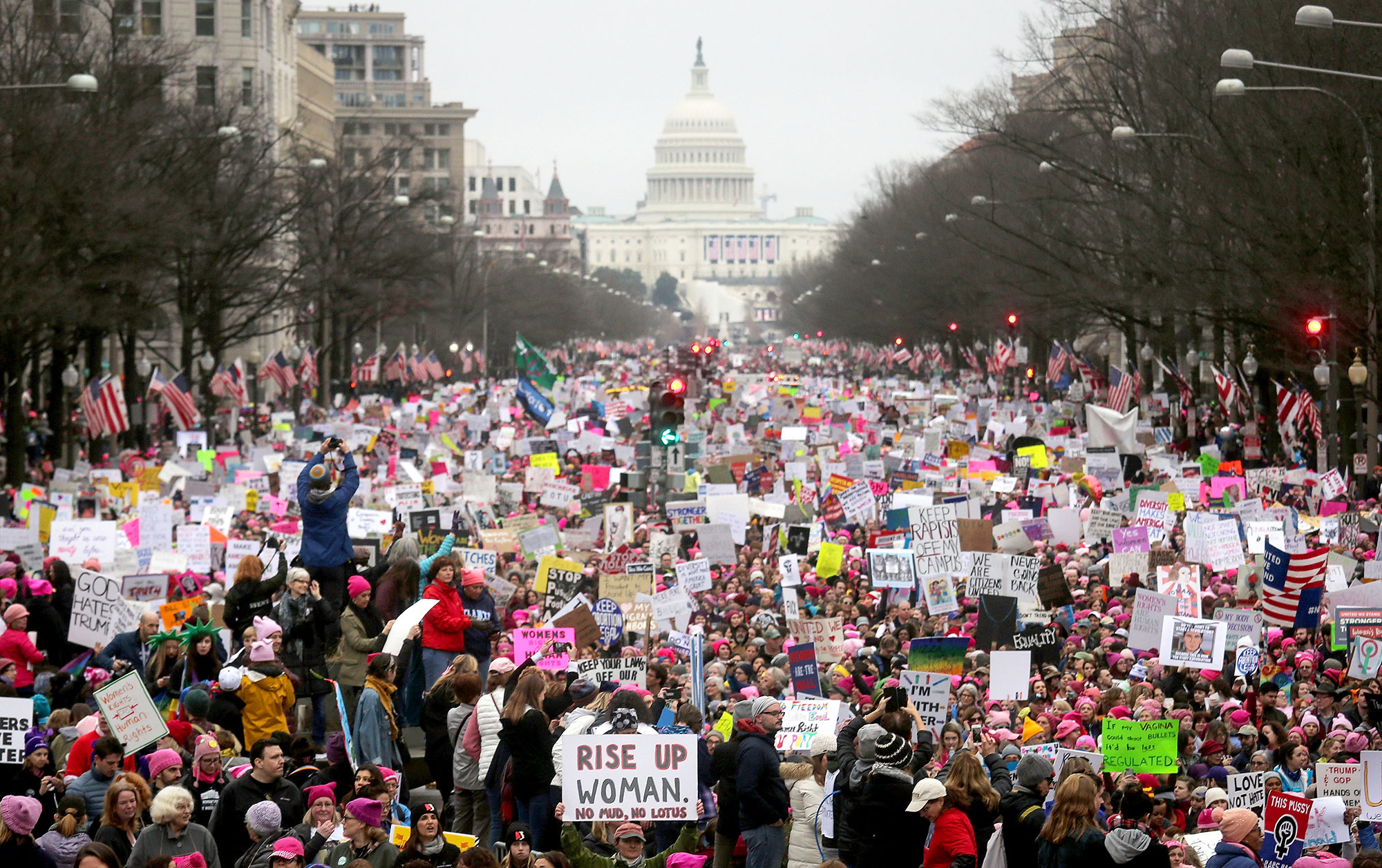 Protesters walk during the Women's March on Washington, with the U.S. Capitol in the background, on Jan. 21, 2017.