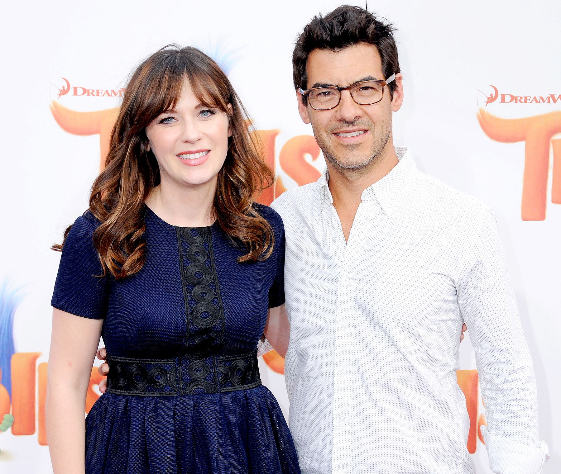 Zooey Deschanel and Jacob Pechenik attend the premiere of 20th Century Fox's 'Trolls' at Regency Village Theatre on October 23, 2016 in Westwood, California.