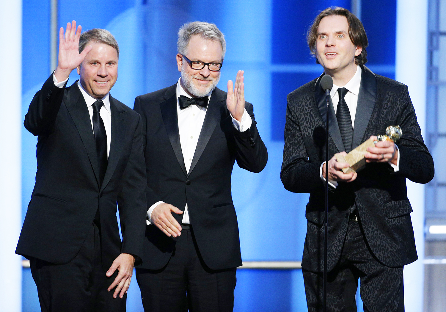 Clark Spencer and directors Rich Moore and Byron Howard accept the award for Best Motion Picture - Animated for